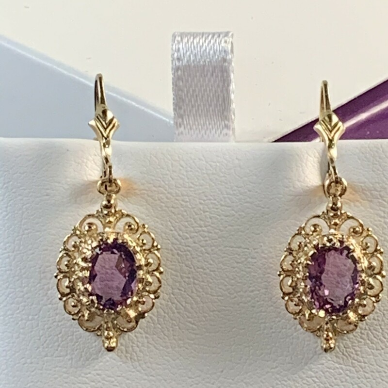 Oval Amethyst with Filigree Border Dangle Earrings Lever back style. 8 x 6mm. Medium color. $355