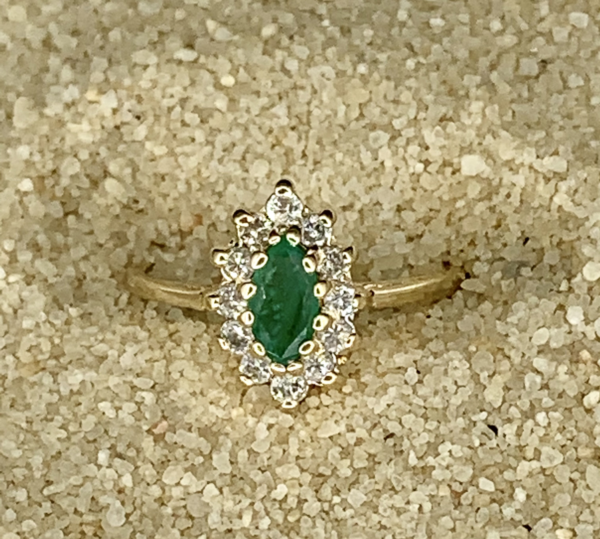 Marquise Natrual Emerald Surrounded by 12 Round Brilliant Diamonds<br /> Diamonds Total .36 carats<br /> <br /> Beautiful RIng with a lot of sparkle. They don't make them like this anymore!