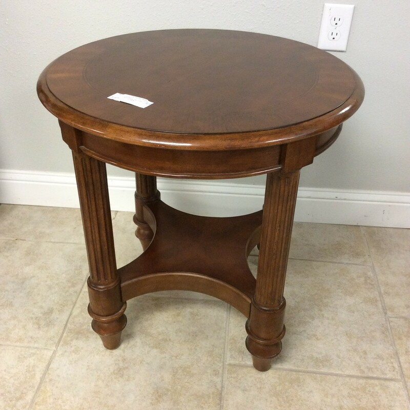This handsome round side table has been made of cherrywood and features nice carved details.
