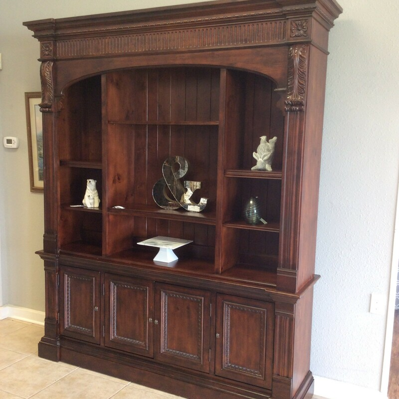 This is a gorgeous display case by Ethan Allen! It features a rich, mahogany wood finish with detailed woodwork, adjustable shelving and cabinets.