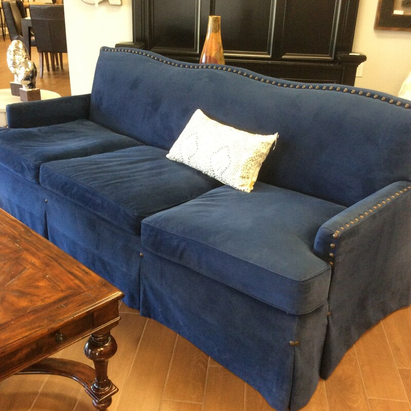 Beautiful navy blue custom sofa. It appears to be a microfiber fabric. It is down stuffed for that extra comfort and has very large nailhead trim. The sofa also has a very pretty skirt around it. It is very comfortable!