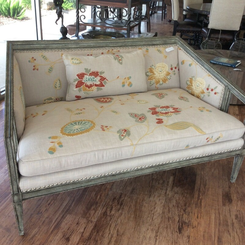 Such a sweet piece! A light tan with crewel embroidery work in rusts, grays, golds and teal. It sits on a distressed gray wood frame. The seat is very wide and comfy.....