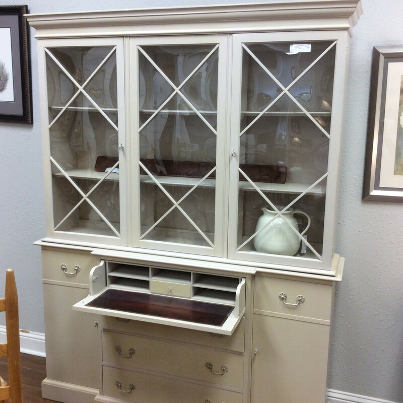 This is an oldie that has been repainted ....and very well! Beautiful beige color. The hutch has two glass doors on the top and plenty of space for nick naks or dinner ware. The front opens to a cute little secretary and the bottom has three drawers and two doors with shelves. This piece is so functional!!!
