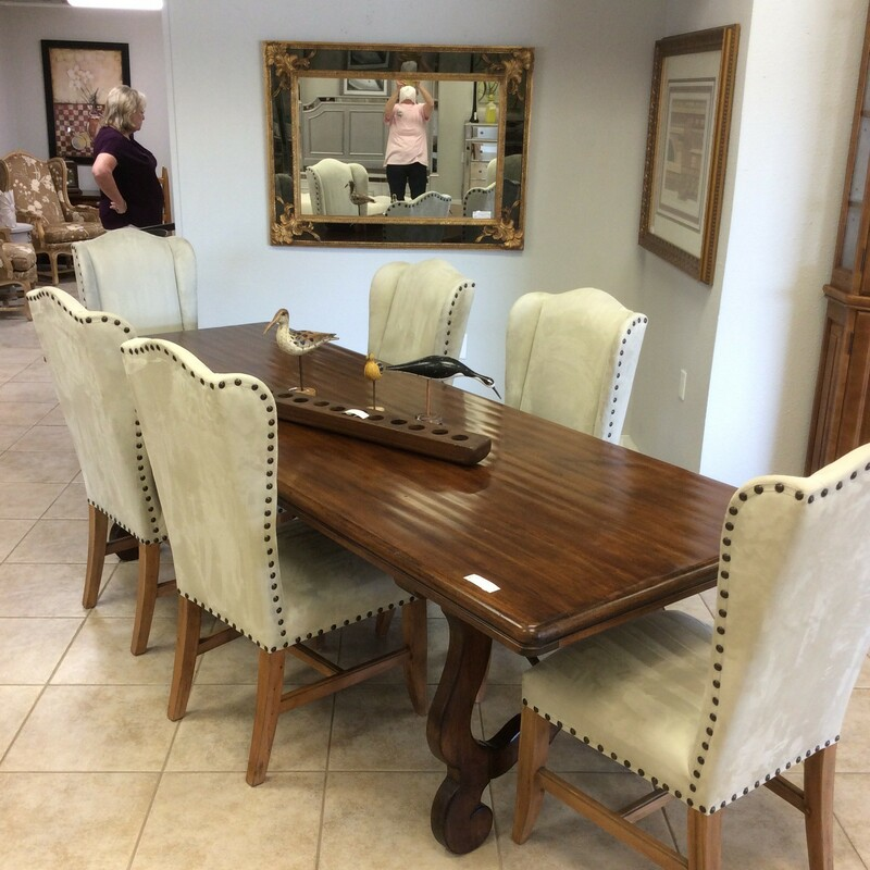 Staff Favorite, you must come in to see this set! By Drexel Heritage, the table features a hand-scraped wood top and a big, bold metal trestle base. The 6 chairs have been upholstered in a gray microsuede and features a nailhead trim all atop a beautiful wood base. Stunning!