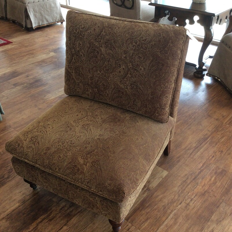This upholstered club chair features a paisley pattern in red and gold. Good condition.