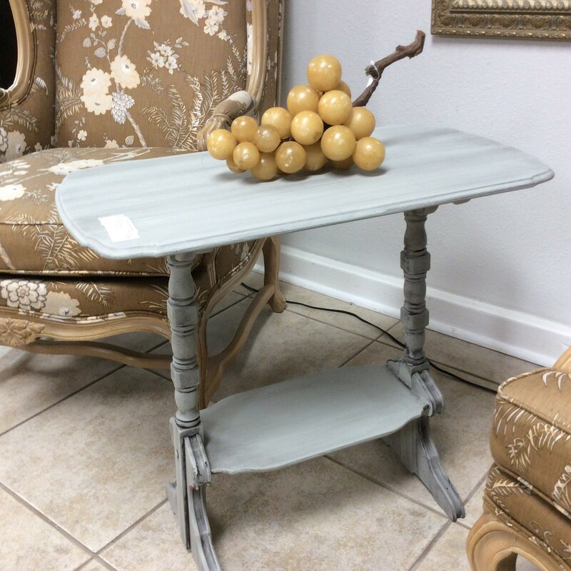 Cute little side table that is painted light grey and kind of a dark grey  wash. It has pretty turned legs and a small shelf underneath. It measures 26x14x24