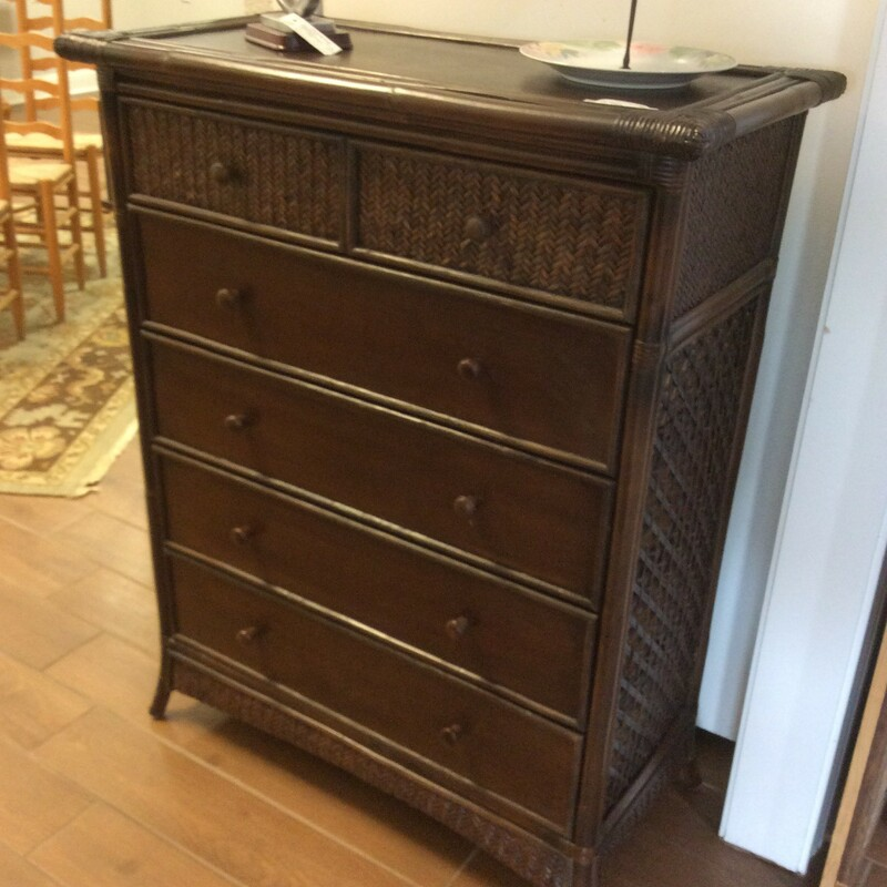 This Pier 1 Dresser is a dark brown in color. It has 6 drawers with wooden knobs. The two top drawers have a wicker front. Measures=36x18x46