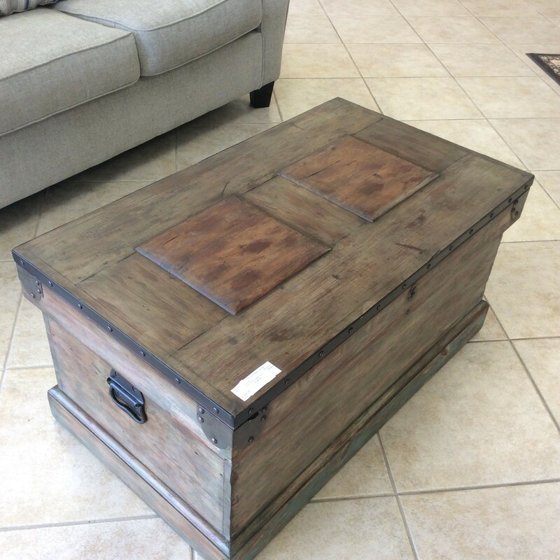 Beautiful french storage chest. It is a combination of , browns, greens and gray distressed colors. Black metal hardware with nail head trim. Measures=38x22x19
