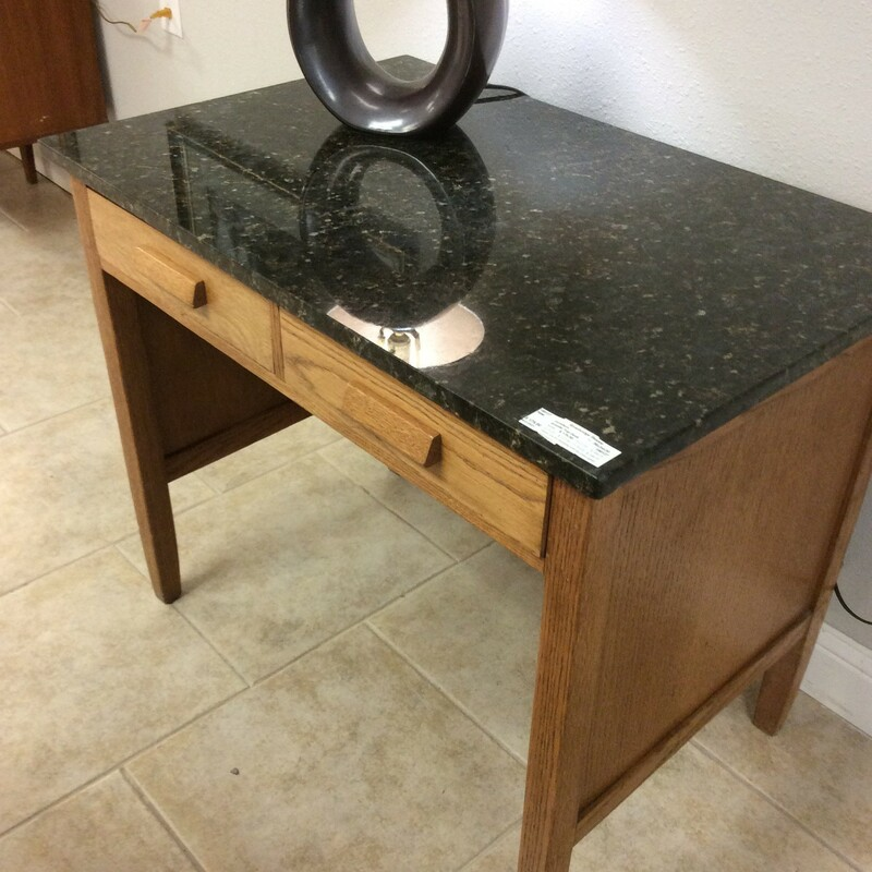 Sweet little vintage light oak desk with a black granite top with specks of gray and browns. It has two slide out drawers with wood hardware. This desk would fit into any space......