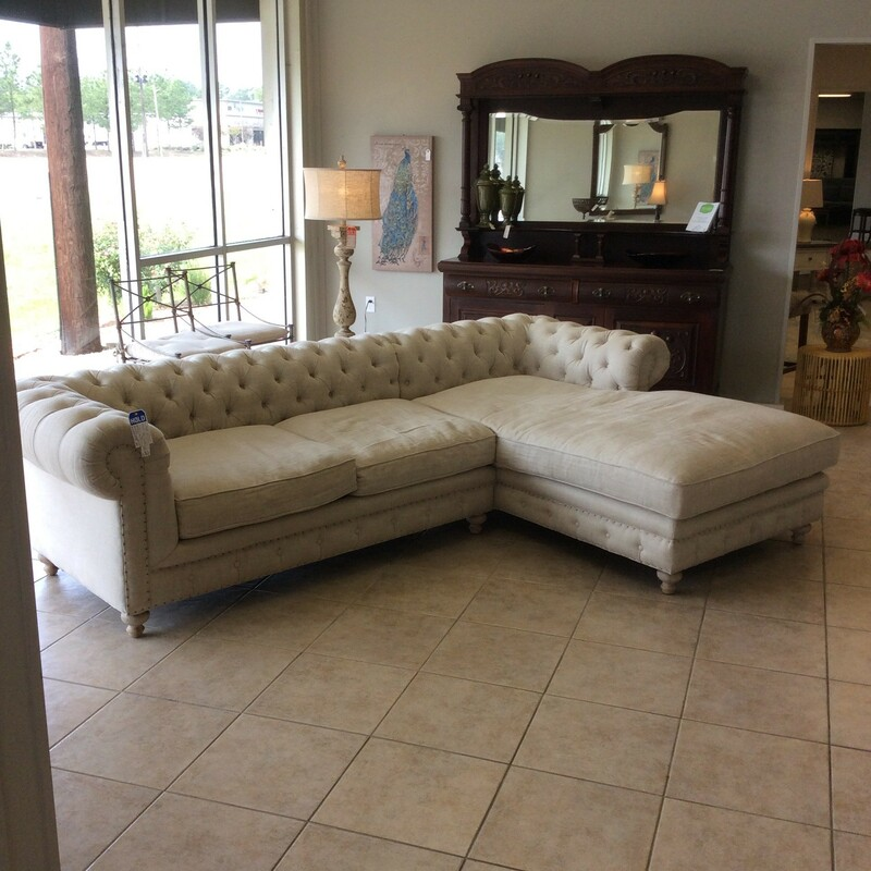 Oh, so elegant!! Originally from Laurie's, this super-sized sofa with an extra large chaise will put you in the lap of luxury. You will want to social distance! Upholstered in a creamy off-white linen, it features a button-tufted back from end-to-end with a nailhead trim.