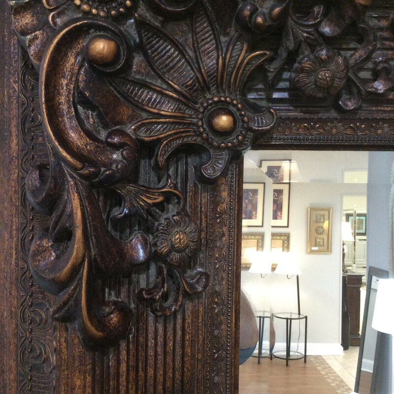 Big, Bold and Beautiful! This large beveled ornate mirror is a beautiful bronze color. It measures 55x78