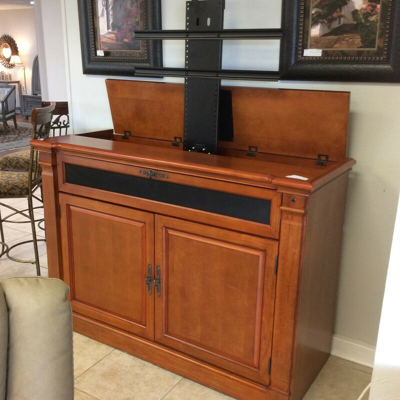 This TV cabinet by Adonzo features a lustrous wood finish and plenty of storage space for media. The TV stores inside and out of sight with an electric lift.