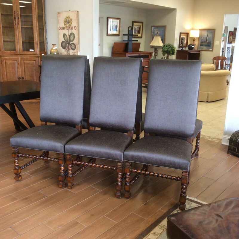 This set of 6 highback chairs feature a  barley twist base and have been upholstered in a charcoal linen upholstery.