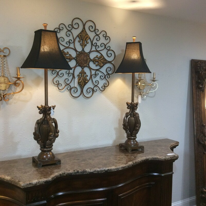 This is a nice pair of tall table lamps with black shades and an ornate base.