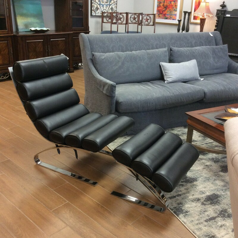 """Bargain Alert! This modern sling chair and ottoman is being sold \""""as is\""""."""