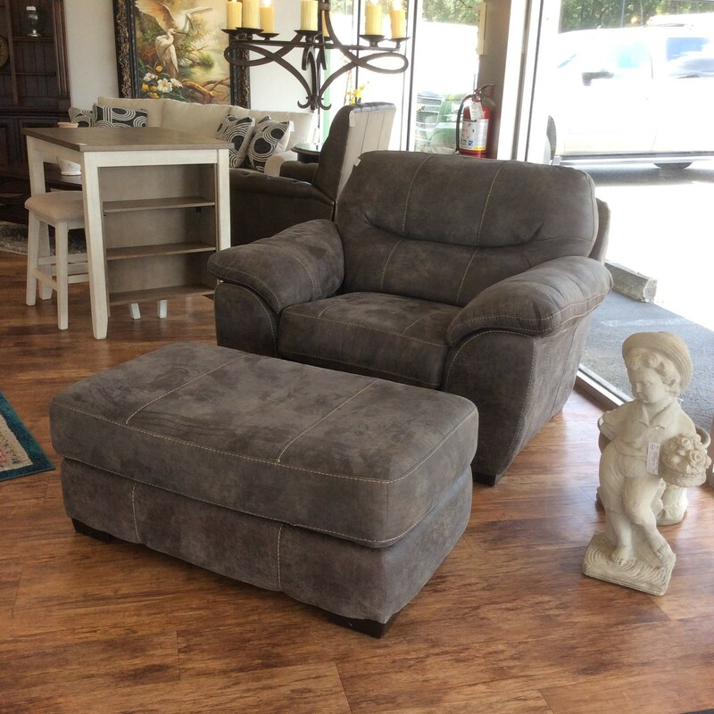 Super-sized and overstuffed but super comfy! This chair and ottoman are gray microsuede with topstitching.