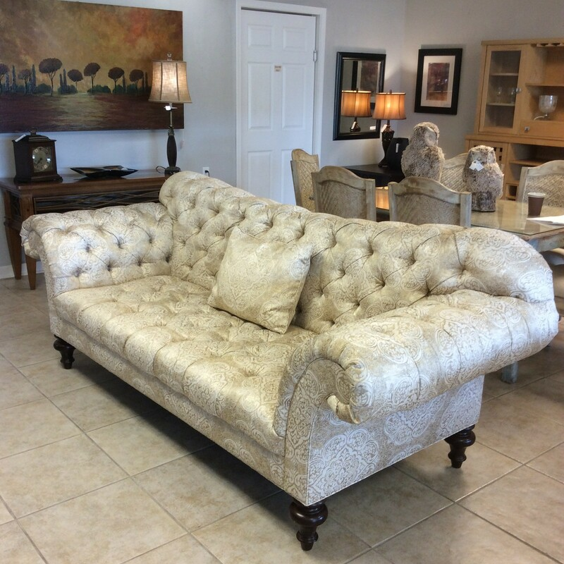 Upholstered in gold and cream, this formal sofa by Sherrill includes rolled arms, button-tufting and 3 accessory pillows.