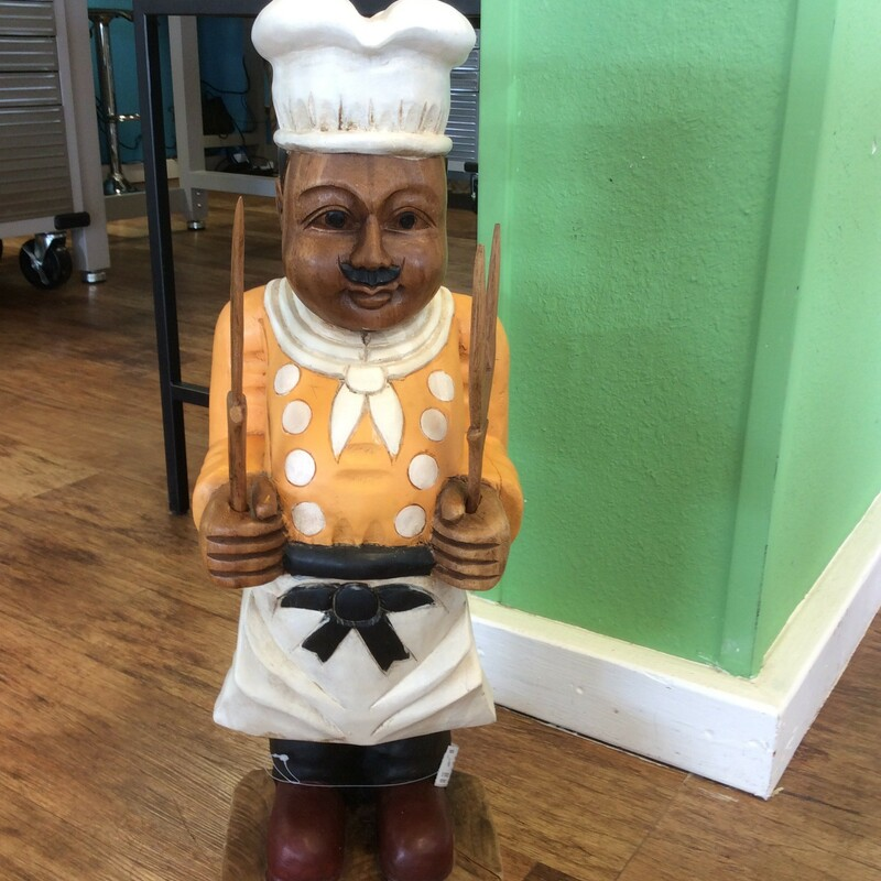 Cute and colorful wood carved chef.