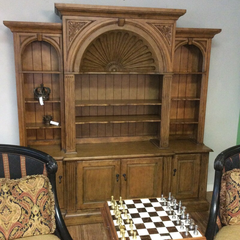 This bookshelf and hutch features a dark wood finish and distressing that softens the appearance and emulates the passage of time. It provides loads of  storage/display space with cabinets, cubbies and adjustable shelving.