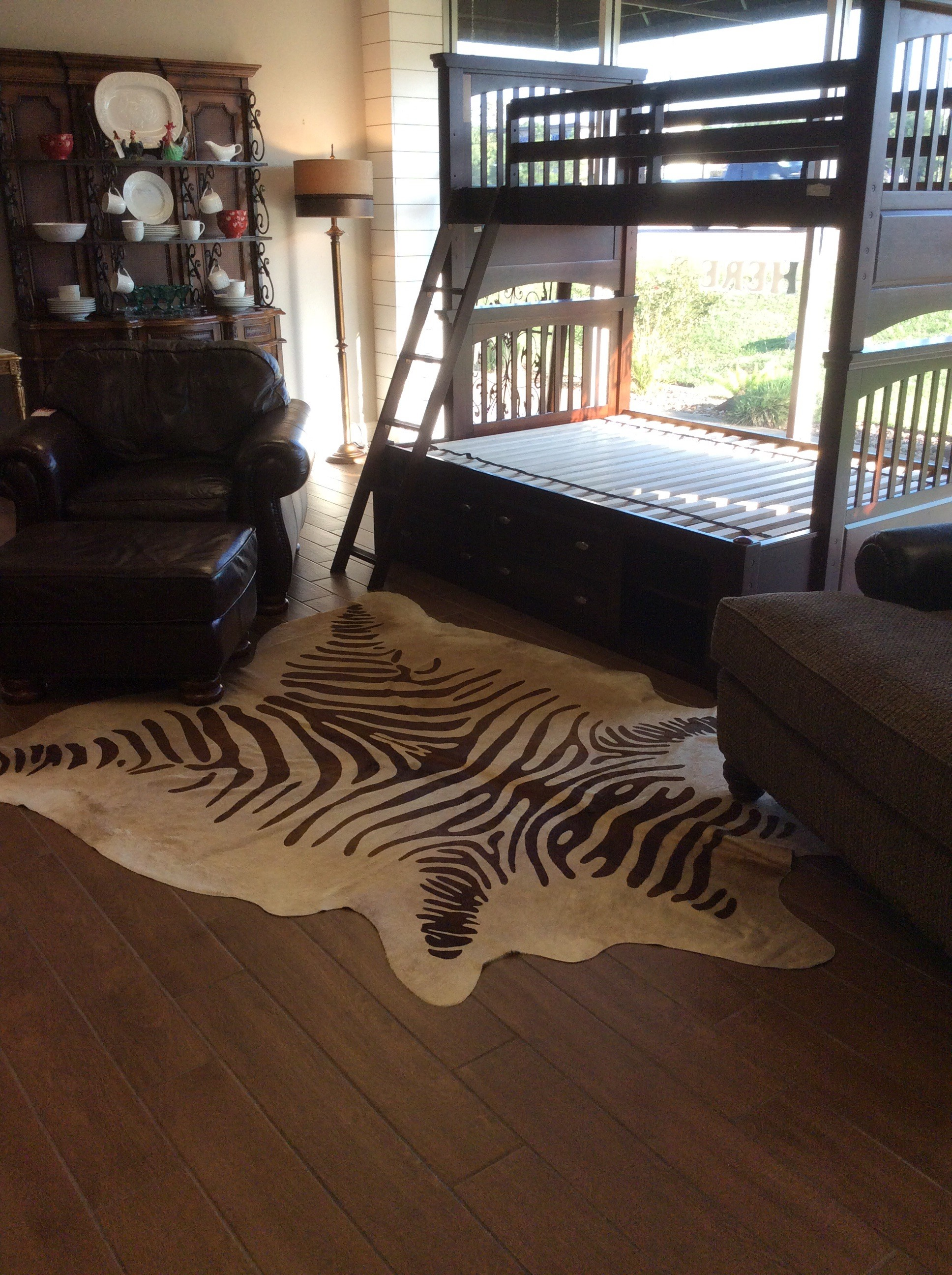 This cowhide has a zebra pattern stenciled onto it.