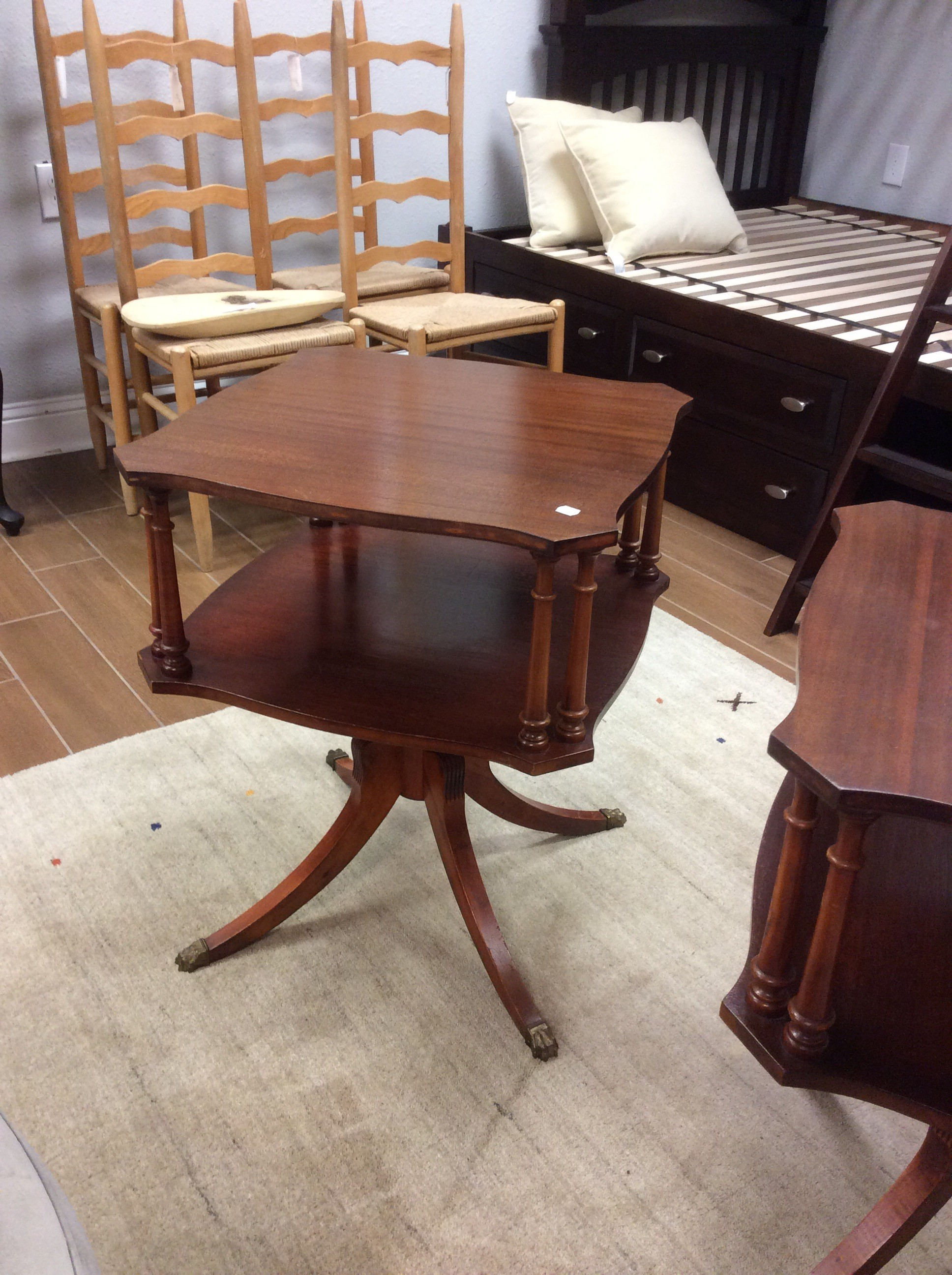 This pretty Duncan Phyfe antique end table features a dark wood finish and is 2-tiered. We have 2 of them.