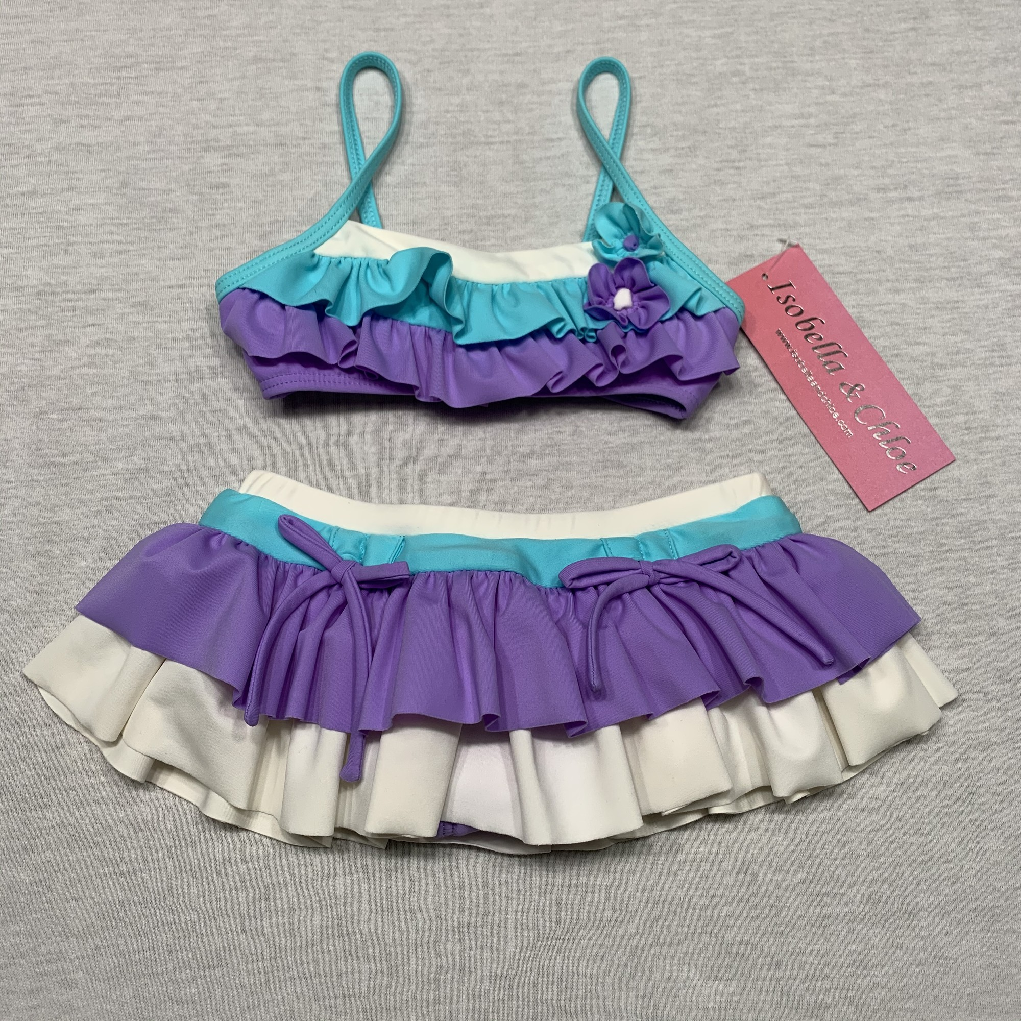 NWT Swimsuit with ruffles & decorative flowers