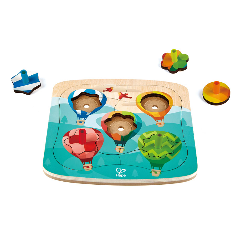 NWT.  This fun puzzle set combines two games in one! Put the pieces together to create a picture of balloons in the sky. The shapes at the center of each balloon are also fun spinning tops!  LOCAL PICK UP ONLY