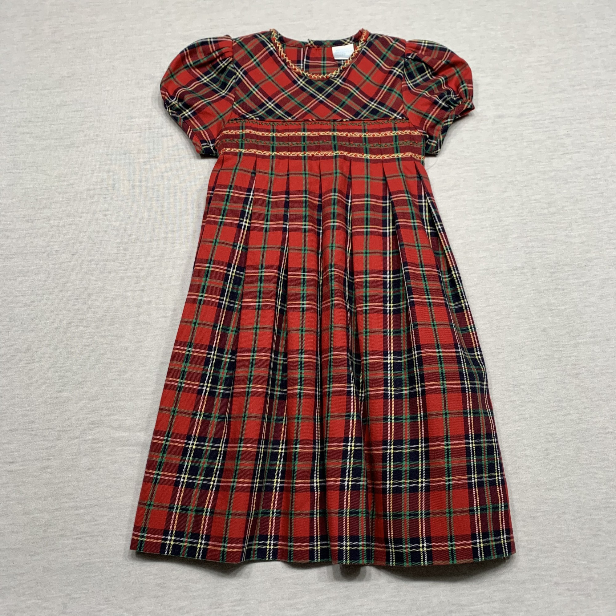 Plaid dress accented with embroidery