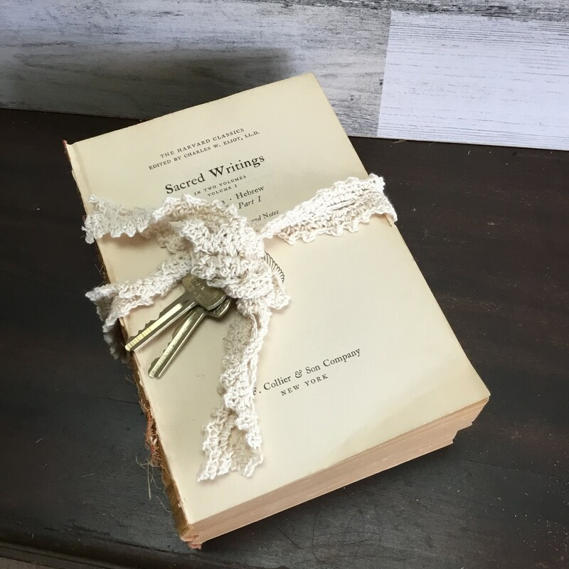These are the perfect fillers or if you just need a little something extra in a space. We took two old books and tied them with vintage lace and added old keys to give them a little charm. The keys and add ons will be different and vary b/c they are old and one of a kind.