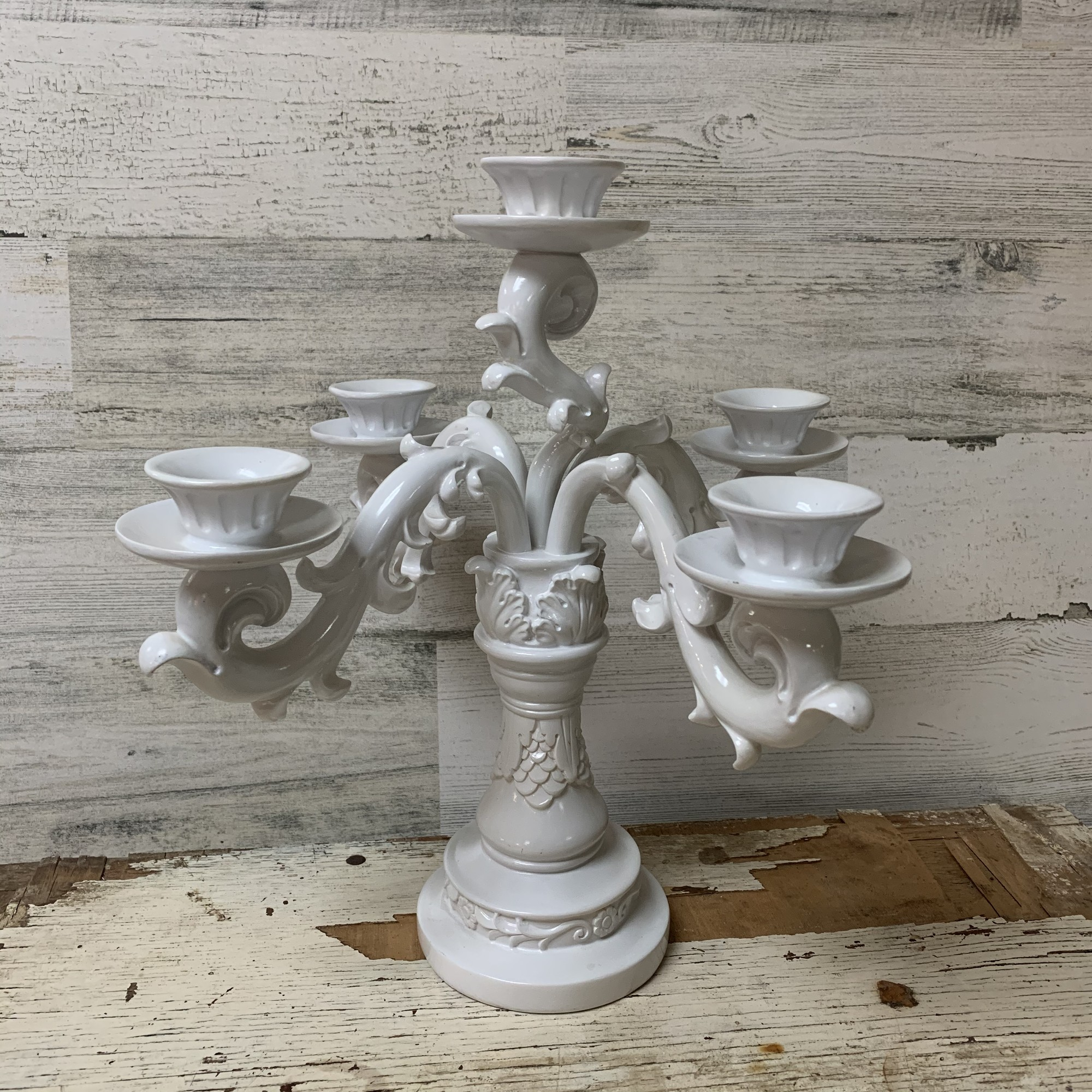 Elegant polyresin paper candelabra w/ five holes. Perfect for any occasion or celebration.<br /> Measures aprox., 12'' of  total length, 11 3/4'' wide, 4'' base diameter.<br /> In a good condition. Please make sure to look at all the pictures.<br /> Thank you.