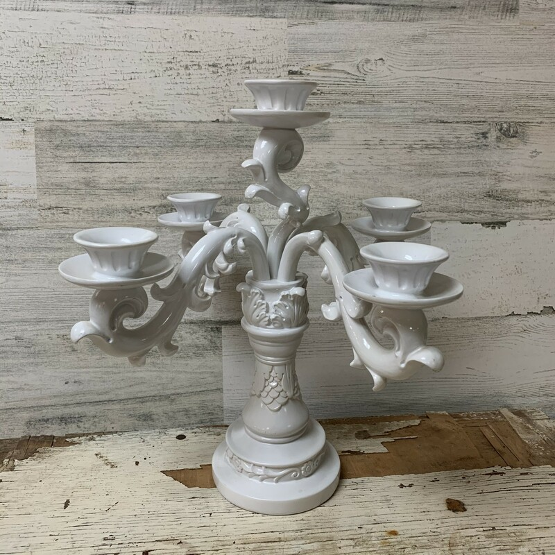 Elegant polyresin paper candelabra w/ five holes. Perfect for any occasion or celebration. Measures aprox., 12'' of  total length, 11 3/4'' wide, 4'' base diameter. In a good condition. Please make sure to look at all the pictures. Thank you.