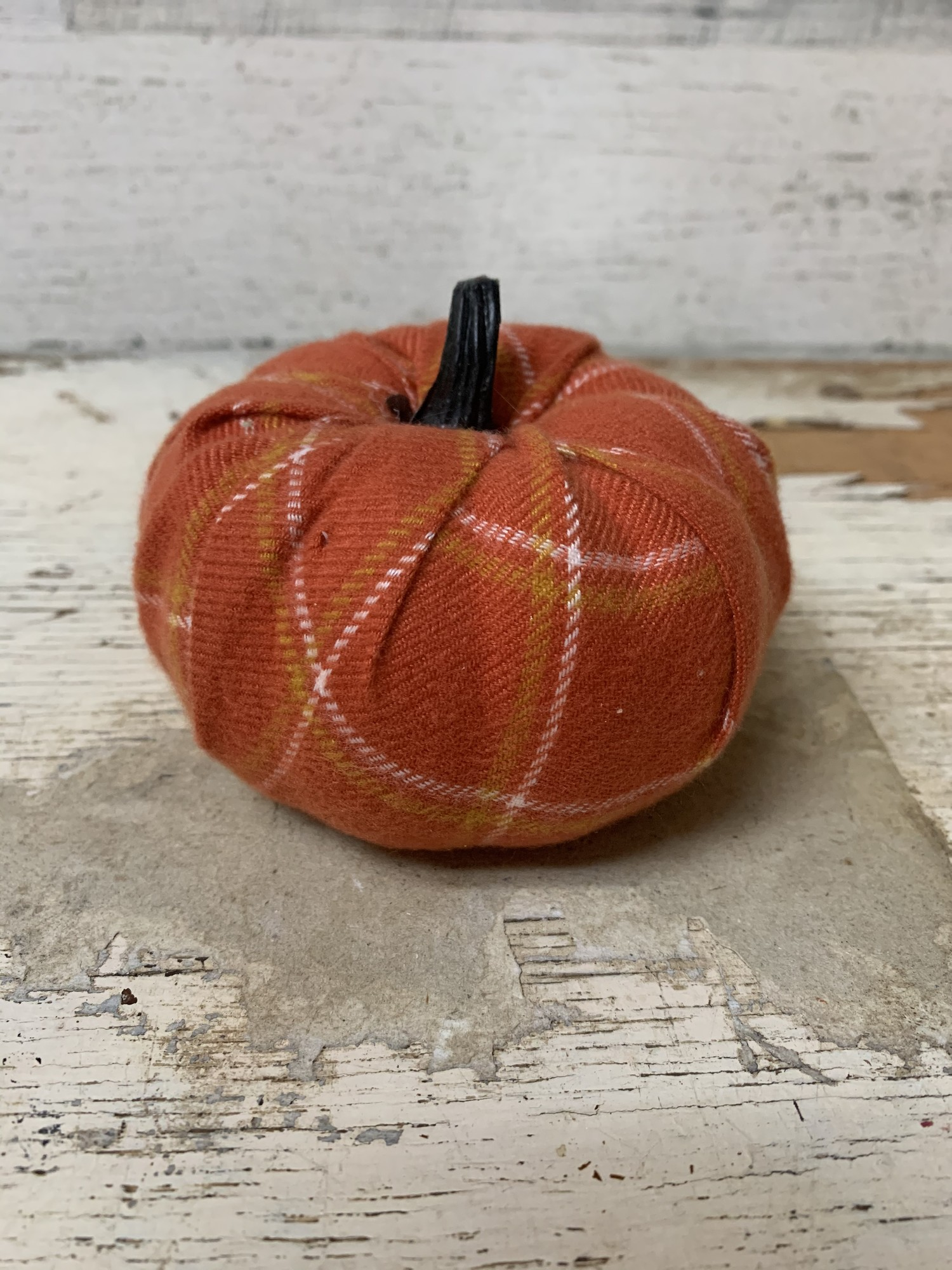 Add a sweet, decorative touch to your fall decor with this Dark Orange Plaid Flannel Fabric Pumpkin.<br /> Perfect little centerpiece, accent, diy projects.  It will definitely welcome fall into you house with style.<br /> Measures approx 3 1/4'' and  3 1/2'' wide.<br /> Please make sure to look at all the pictures!<br /> Thank you so much!