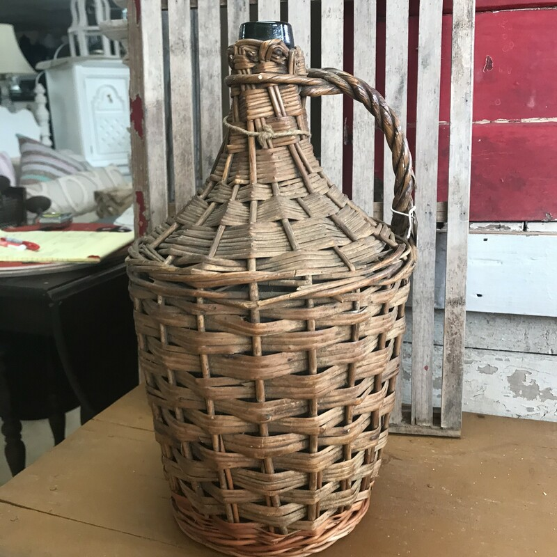 This vintage European wine basket with bottle is a great little accent piece for any space in your home. It measures 16inches tall x 9 inches wide.