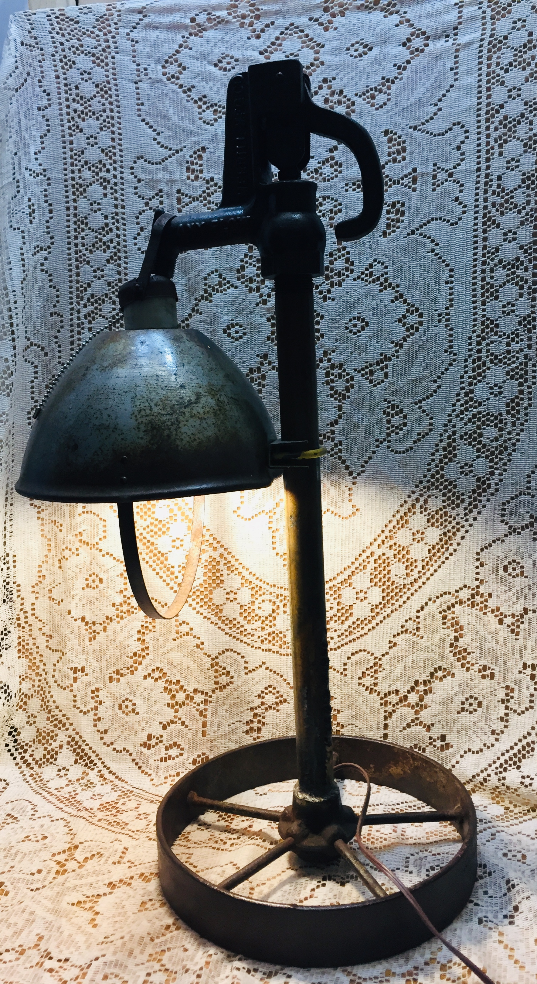 Steampunk pump handle lamp with covered shade.<br /> Clearcoated for proctection.<br /> Bulb included.<br /> <br /> Ht.  28 inches   W  16 inches