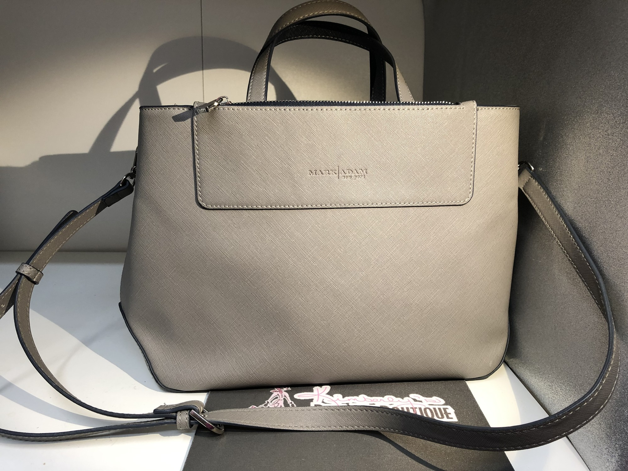 This gorgeous structured, saffiano leather tote retails for $110 in a pretty shade of grey with navy zips in excellent preloved condition. Might be mistaken for New!