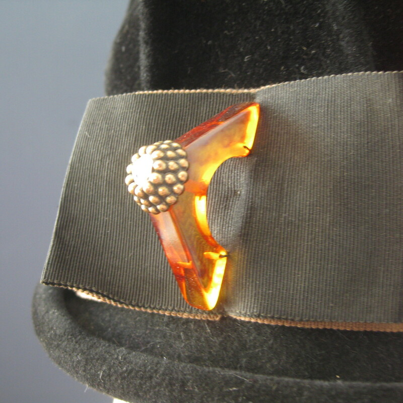 This simple tall crowned black hat is made of felt. It has an absolutely amazing lucite decoration on a wide gros grain ribbon. Excellent condition. Small size : Inner hat band measures 21in around  thanks for looking1 #10801