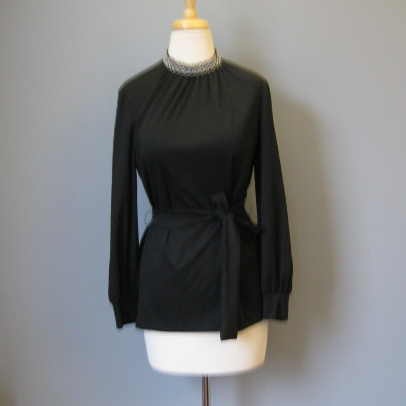 Cute 70s glam separate in black High gathered neckline with silver lurex braid decoration Sash Belt by Kay Windsor no size tag Flat measurements shoulder to shoulder: 15.5 armpit to armpit: 19in underaram sleeve seam length: 17in waist: 13.5in Length : 27in  thanks for looking! #15227