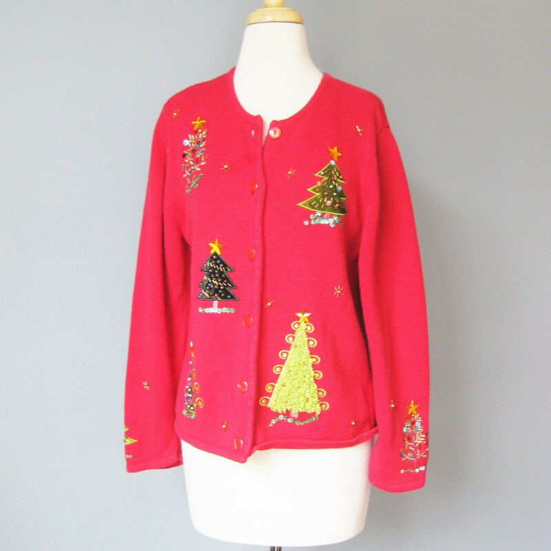 very pretty red cardigan with a Cheery Christmas Theme. Really nicely worked Tree appliques, and beading, even on the sleeves by Krystal Kobe Size M 55% ramie 45% cotton red plastic buttons Flat measurements: armpit to armpit: 19.5in width at hem: 20.25in underarm sleeve seam length: 16in length: 22.25in  perfect condition Thanks for looking1 #15943