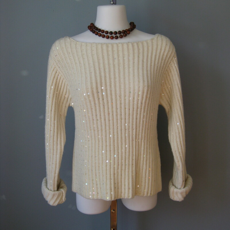 Cute cozy sweater perfect for date night. it's off white with the same color sequins throughout for a decent amount of sparkle for a modern shimmery look. Extra long sleeves Ribbed Pullover size small flat measurements: bust: 17.5in, length: 19.5in stretchy thanks for looking #15999