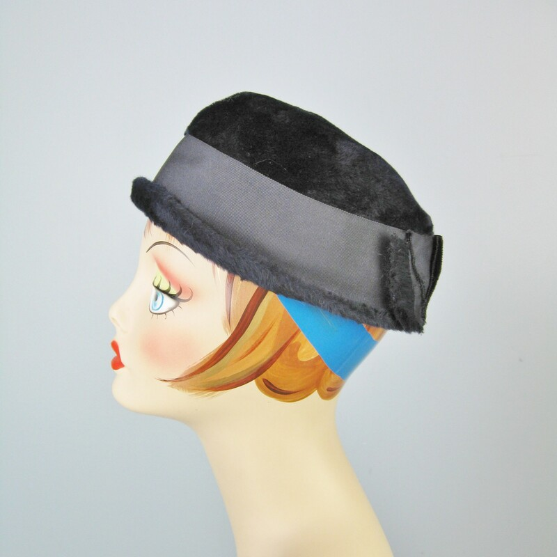 Simple winter hat in very dark navy blue fur velour from the 1950s It's basically a pillbox with a teeny brim and a wide folded grosgrain ribbon around the crown. The ribbon forms a tailored flat bow with frayed edges.  Stamped  Ballet Made in Czechoslovakia  Great condition, except for the ribbon being slightly discolored at the back. Inner hat band measures: 21 1/4  Thanks for looking. #31262