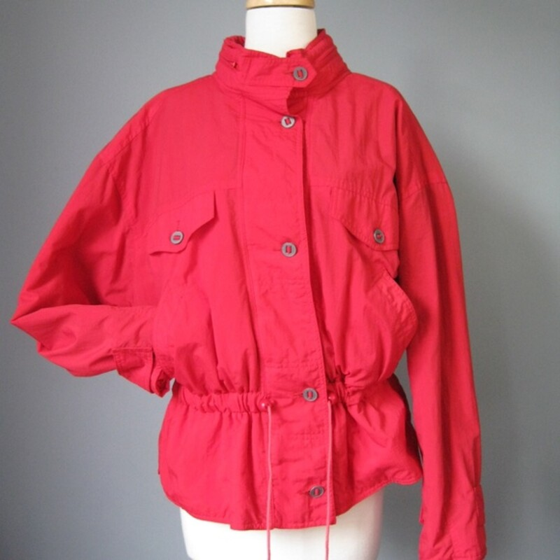 Cinchable red ski shell or jacket  from the 1990s Brand: At Ease Zippered front with metal buttons Hood hides in the zipper around the neck Blue Quilted satin lining Bright Red Size Large Made in Malaysia  Flat measurements (Please double where appropriate): Armpit to armpit: 29in Length: 25 3/4in  Thanks for looking! #25514