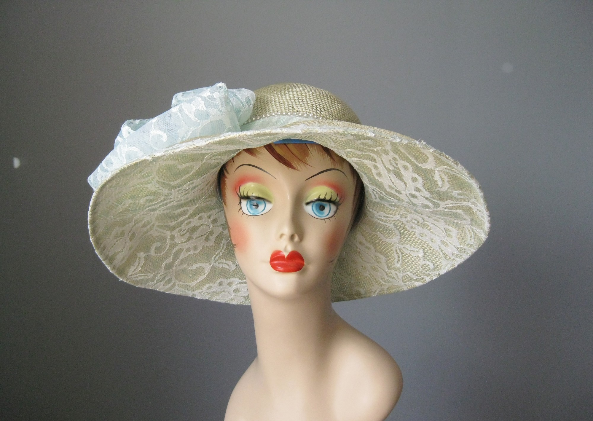Frame your face at your next racing meet in this gorgeous high quality sunhat.<br /> by Mysha<br /> <br /> NWT but probably from the 80s or 90s<br /> USA<br /> All natural straw, synthetic lace, rhinestones<br /> The straw is uncolored, the lace is the palest green, almost white<br /> Cicumference: 21 1/2in<br /> Thanks for looking!