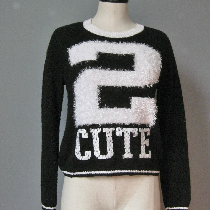 Front of the shirt says it all. Irresistable little sweater girls size 14, would also fit a teen or small woman,  armpit to armpit: 19in length: 19 1/2in  65% cotton, 22% acrylic, 13% poly  Perfect condition thanks for looking!