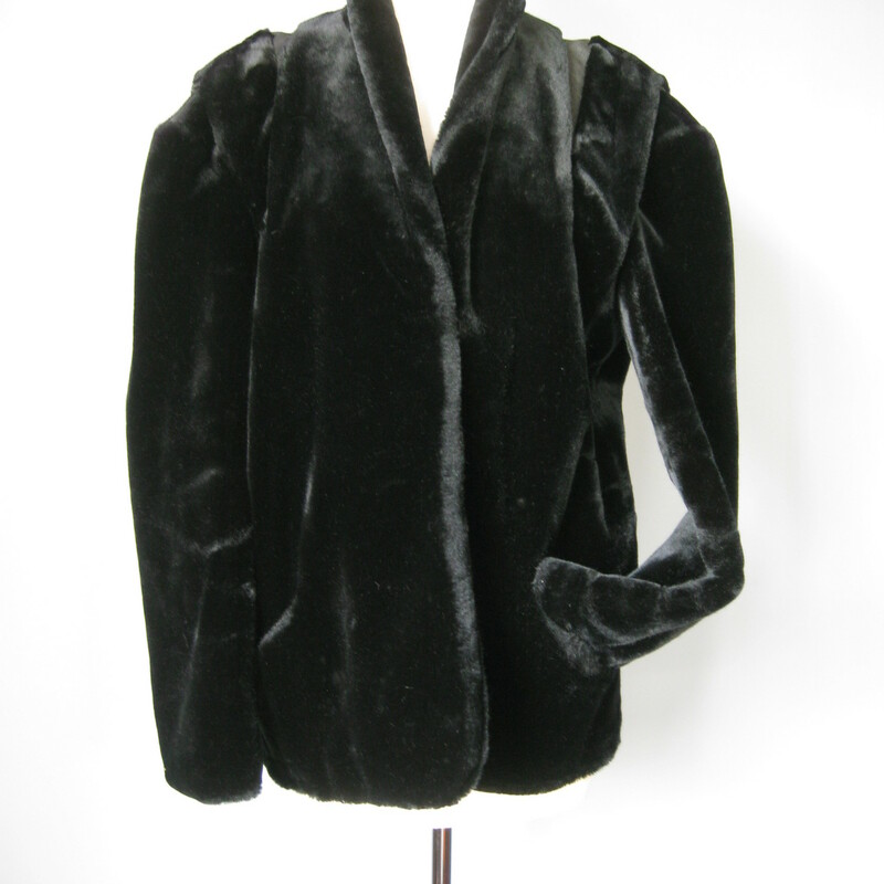 High quality luxurious faux fur coat from the 1980s. The fur feels soft and natural. Hook and eye closures. It's a boxy coat, with a the 80s emphasis on the shoulder. Here in the form of leather inside across the back of the shoulders.  Fully lined in black satin. Side pockets No Labels  This coat should fit up ot a modern large at least.  Here are flat measurements of the coat, please double where appropriate.  Armpit to Armpit: 24 1/2 measured on the INSIDE  Overall length: 27in