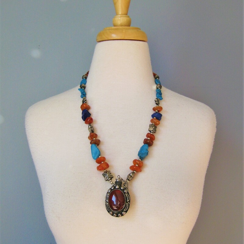 Fabulous middle eastern necklace featuring a large vial for perfume or potions. the necklace combines turquoises with translucent and opaque orange stones. The vial is decorated on both sides, a plain red stone on one side and a black and yellow striated stone on the other side. Heavy and amazing  simple hook clasp necklace length: 24in  thanks for looking1 #34050