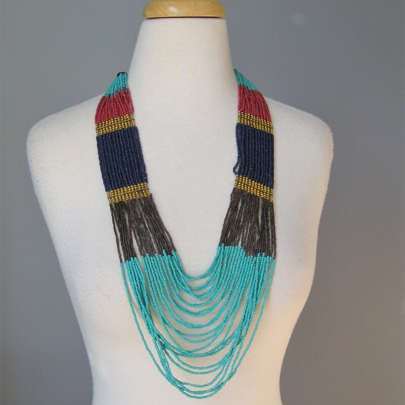 From a collection of middle eastern jewelry collected by a now retired world traveler.  This piece features multiple strands of light weight blue brown red and turquoise colored beads accented with round gold metal beads The effect is very ancient Egyptian  lenght 32in  thanks for looking! #34053