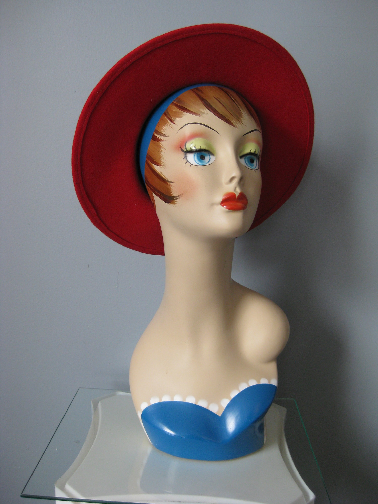 Fun 1980s vintage hat from Madcaps<br /> Round Crown wide brim in red wool felt with a wide black ribbon and tailored bow.<br /> Made in the USA<br /> Inner hat band measures 21.5in around<br /> <br /> Thanks for looking!<br /> #34388