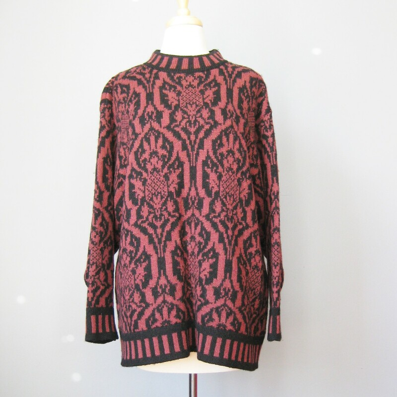 Winter weight wool sweater from Laura Ashely 100% wool Burgundy and Black large abstract paisley like pattern with blocks of black and burgundy at neck and hem and sleeve ends made in Scotland Marked size M/L Flat measurements: armpit to armpit: 23.25in length: 27.75in width at hem 24in  excellent condition! #35408