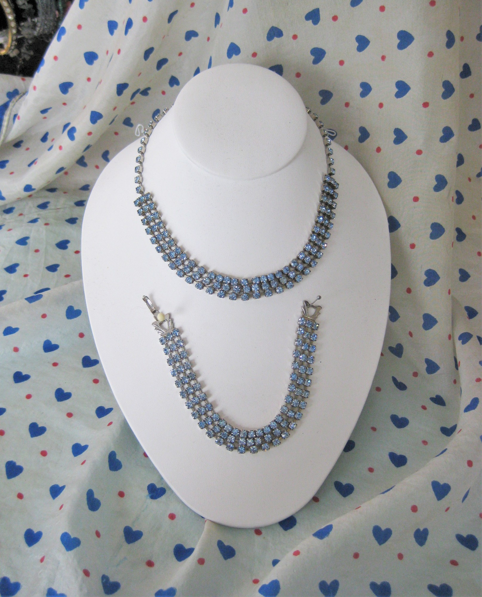 Pretty blue rhinestone set<br /> Choker length necklace and matching bracelet<br /> each has three rows of small square blue rhinestones in metal settings.<br /> necklace: 15.25in<br /> bracelet: 7in<br /> <br /> Thanks for looking!<br /> #36069