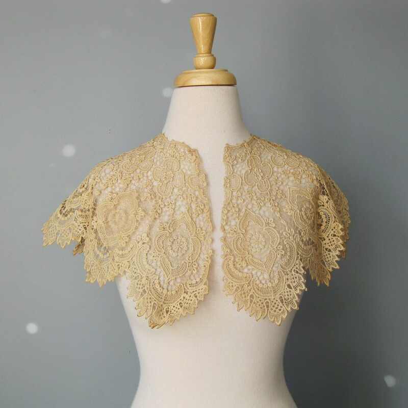 NWT Lace Collar, Beige, Size: N This delicate collar is made of cotton lace. Darkish ecru color It would look beautiful over a sweater or high neck blouse or even over a strapless top or dress.  It drapes beautifully over the shoulders and collar bones.  Excellent condition, never used, it does have a very small amount of uneven darkening around the edges here and there, but it's very diffuse (not spots) and not very noticeable  It measures 43in around at the middle of its depth and it is about 9.75in deep. No closure, it's big enough and has enough weight to sit on the shoulders, if wearing over bare shoulders and planning on a lot of moving around, you might consider adding a brooch to keep it closed at the front.  Thank you for looking. #36302